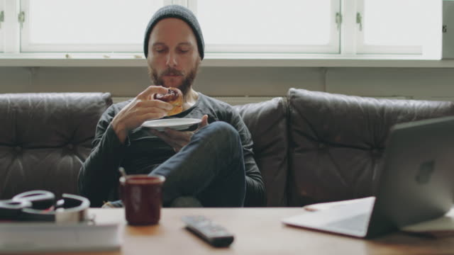 man relaxed at home, takes a break - muffin stock videos and b-roll footage