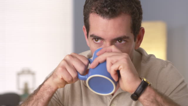 Man relaxing at home with a cup of coffee