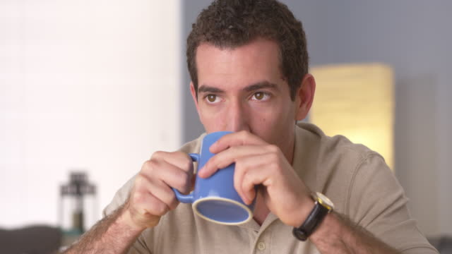 Man relaxing at home with a nice cup of coffee