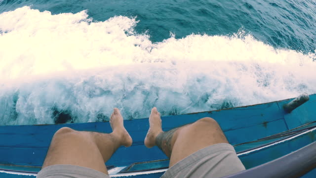 man relaxing during cruise on a sailing boat - human foot stock videos & royalty-free footage