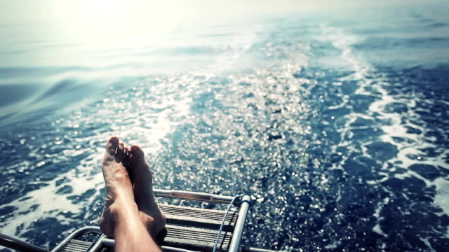 stockvideo's en b-roll-footage met man relaxing during cruise on a sailing boat - nautical vessel