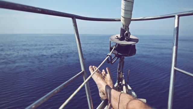 Man relaxing during cruise on a Sailing Boat