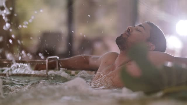 man relaxing in a hot tub at spa - hot tub stock videos & royalty-free footage