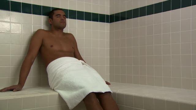 A man relaxing in a towel