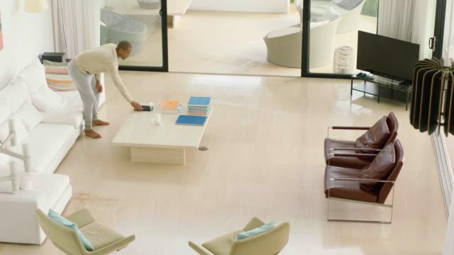 Man relaxing in luxury home