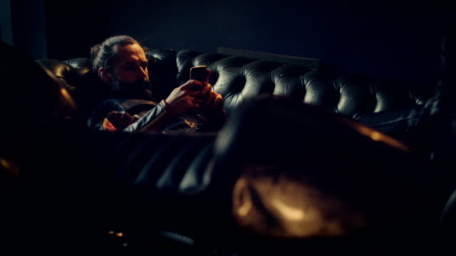 man relaxing in motorcycle workshop - motocross stock videos & royalty-free footage