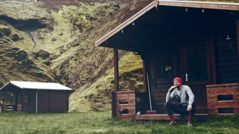 man relaxing on cabin's porch. looking at view - porch stock videos & royalty-free footage