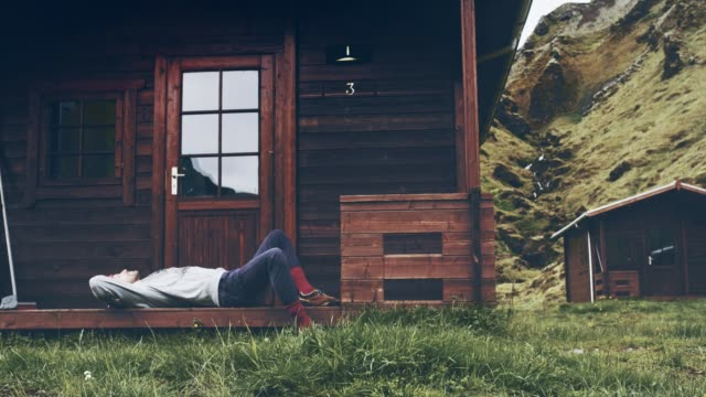 man relaxing on cabin's porch. looking at view - front porch stock videos and b-roll footage
