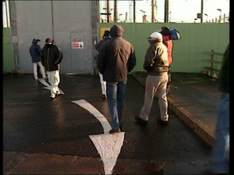 man released from prison walking along nireland belfast ext gvs people waiting outside prison / prison gates opened two men out from prison / gvs as... - loslassen aktivitäten und sport stock-videos und b-roll-filmmaterial