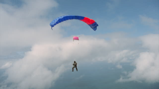 man releases his parachute and falls away - parachute stock videos & royalty-free footage