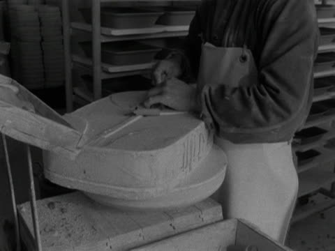 man removes a clay dish from a mould at the stavanger pottery workshop. 1959. - stavanger stock videos & royalty-free footage