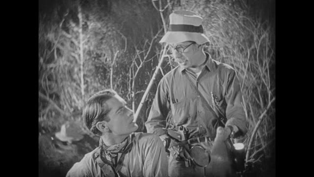 stockvideo's en b-roll-footage met 1925 man removes tick from his neck, frustrating bug explorer with magnifying glass - vergrootglas