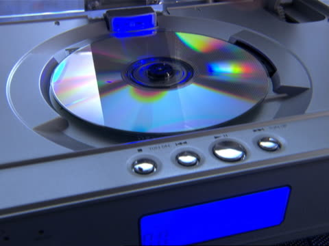 Man Removing CD from CD Player