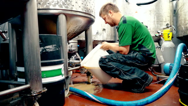 man removing yeast from tank - yeast stock videos & royalty-free footage