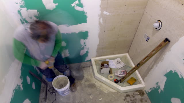 t/l, ws, ha, man renovating bathroom - renovierung themengebiet stock-videos und b-roll-filmmaterial