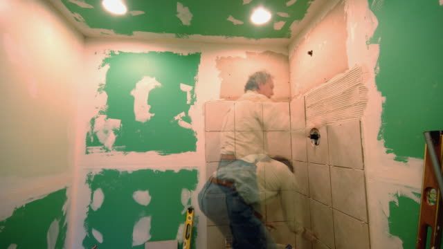 t/l, ms,  man renovating bathroom - renovierung themengebiet stock-videos und b-roll-filmmaterial