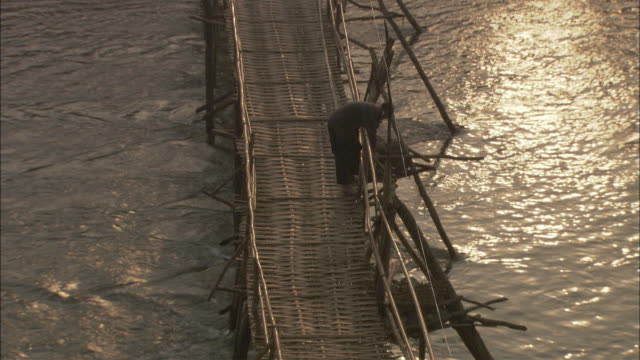 WS HA Man repairing footbridge, Cambodia