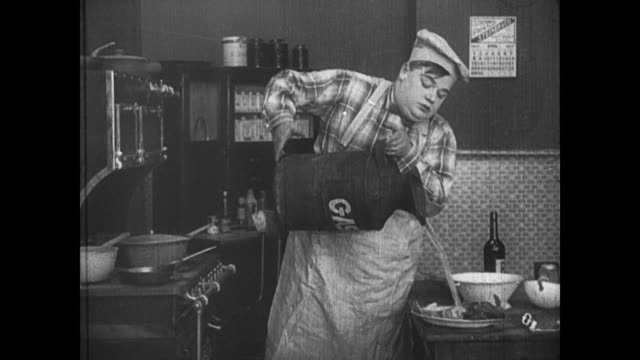 1918 man (fatty arbuckle) replaces an ingredient, rum, with gasoline and sets the table on fire - rum stock videos and b-roll footage