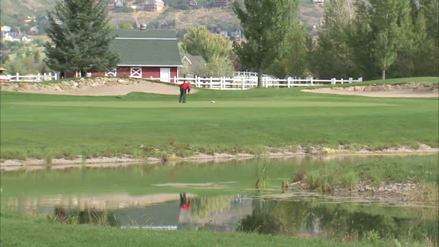 ls ws man replacing flags on golf course / provo, utah, usa - provo stock videos & royalty-free footage