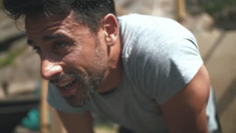 vídeos y material grabado en eventos de stock de hombre de reclinación después de entrenamiento - resistencia
