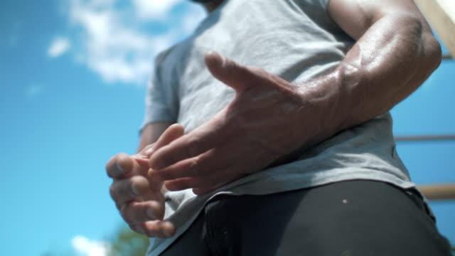 vídeos y material grabado en eventos de stock de hombre de reclinación después de entrenamiento - consumido