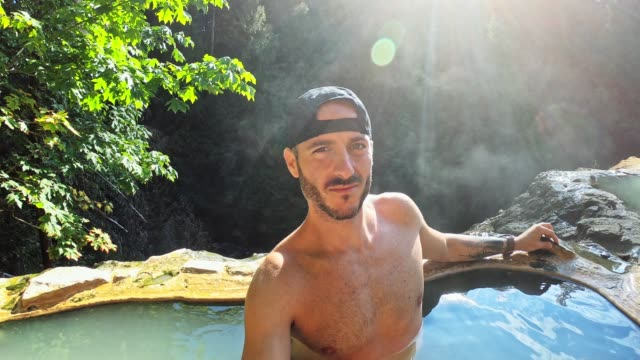 man resting in an hot spring in oregon - umpqua national forest stock videos & royalty-free footage