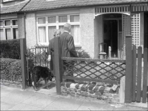 New Southgate William Shone and his guide dog 'Bob' along into garden of his friends' house CMS Mr Shone seated with Bob between his legs pull back...