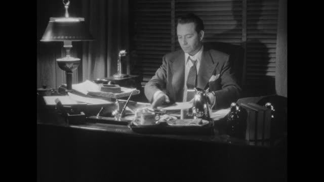 vídeos de stock, filmes e b-roll de 1948 man reviews stock sale confirmations while seated at desk - ação da bolsa de valores
