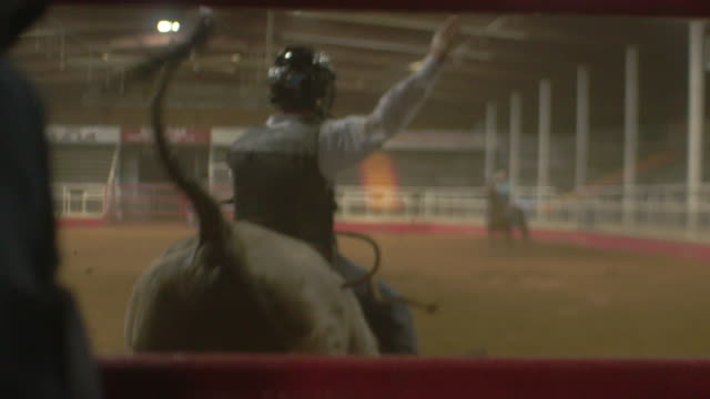 man rides bull and falls in slow motion - rodeo stock videos & royalty-free footage