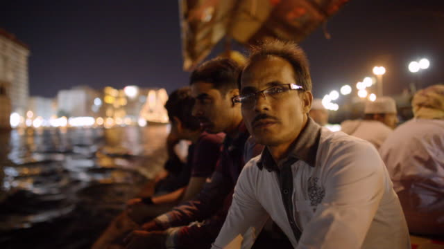 Man rides dhow boat across Dubai Creek at night