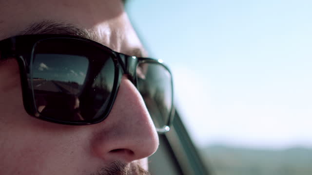 a man rides his car in a sunny day - sunglasses stock videos & royalty-free footage
