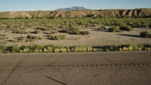 man rides motorcycle down desert highway - sandy utah stock videos and b-roll footage