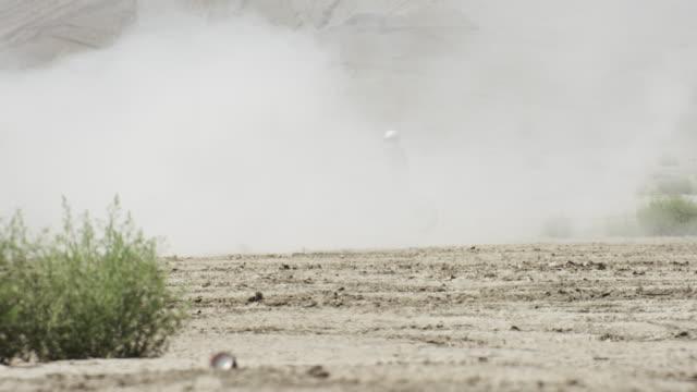 man rides motorcycle in desert - sandstorm stock videos & royalty-free footage