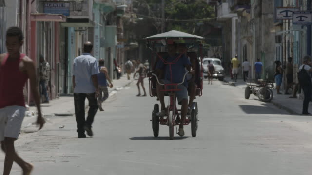 man rides pedicab in cuba - pedicab stock videos and b-roll footage