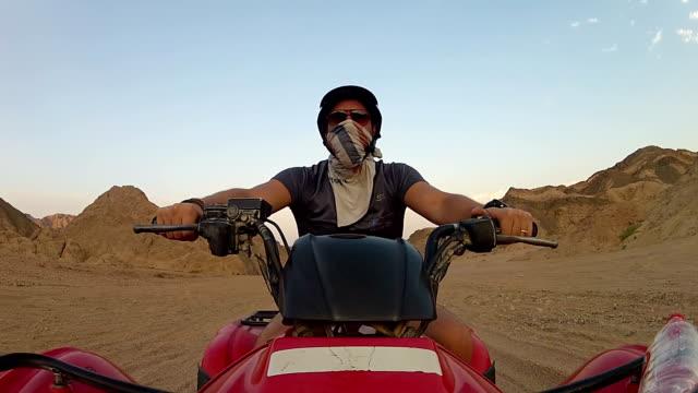 man riding a atv - quadbike stock videos & royalty-free footage