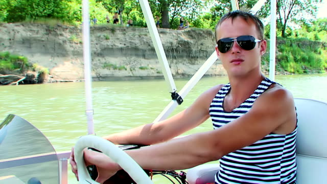 Man riding a boat