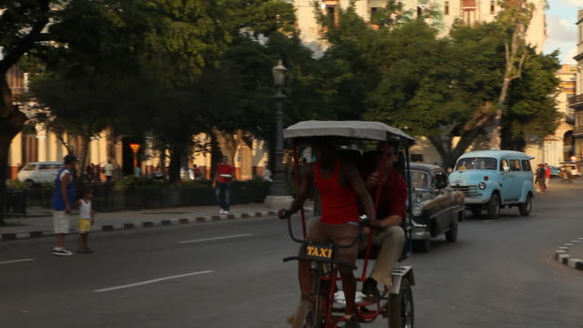 MS of Man riding a Cuban pedicab in Havana