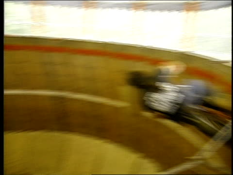 man riding a motorcycle in a 'wall of death' attraction - week stock videos & royalty-free footage