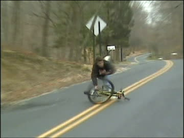 ms, zo, zi, man riding bicycle, jumping off and falling on road, usa - wreck stock videos & royalty-free footage