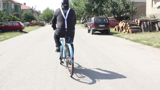 man riding bicycle - offbeat stock videos & royalty-free footage