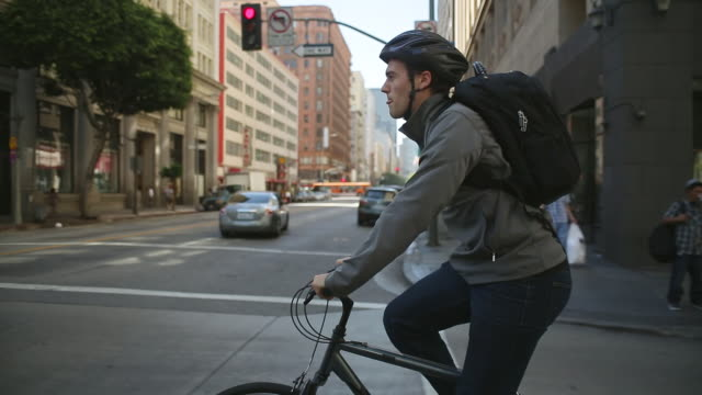 man riding bike in bike lane - riding stock videos & royalty-free footage