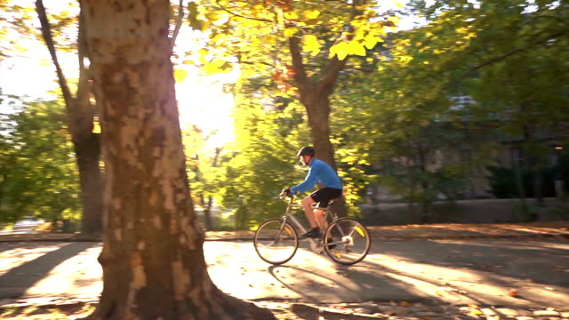 Man Riding Bike in Park