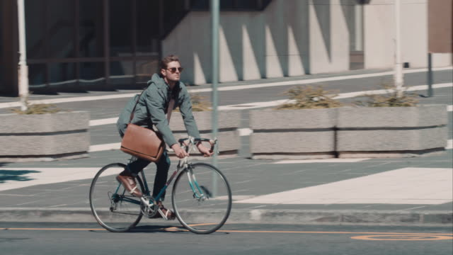 man riding bike in urban setting - males stock videos & royalty-free footage