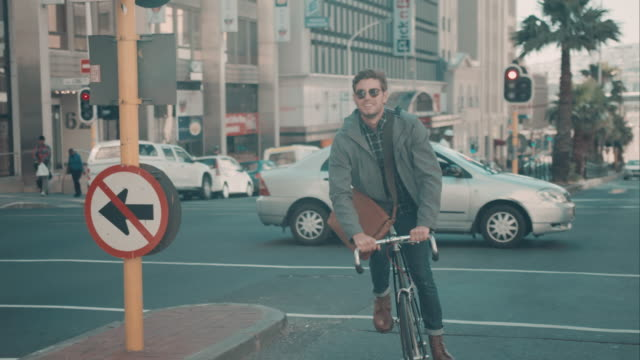 Man riding bike in urban setting