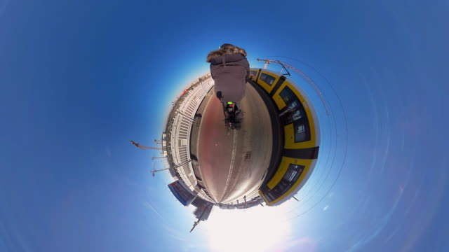 Man riding bike on a Tiny Planet Berlin Wahrschauer Bridge- 360°