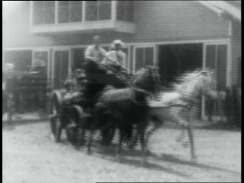 stockvideo's en b-roll-footage met ws man riding by on horse fire wagons pulled by horses coming out of fire station another horse drawn wagon going by / republic of panama - paardenkar