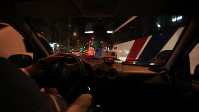 WS POV Man riding cab at night  / Rio De Janeiro, Brazil