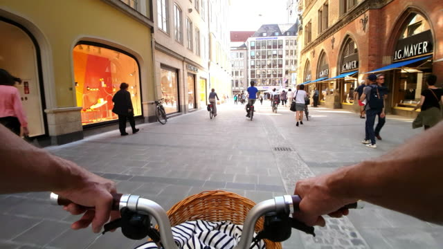 man riding folding bicycle in munich diener street - zona pedonale strada transitabile video stock e b–roll