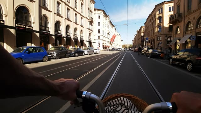 man riding folding bicycle in munich maximilian street - boulevard stock videos & royalty-free footage