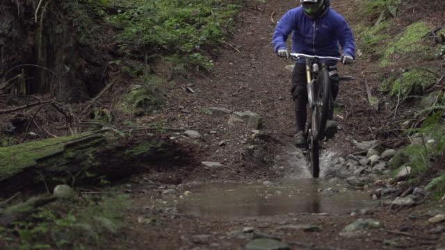 a man riding his mountain bike. - slow motion - 1920x1080 - filmed at 240 fps - mountain biking stock videos & royalty-free footage